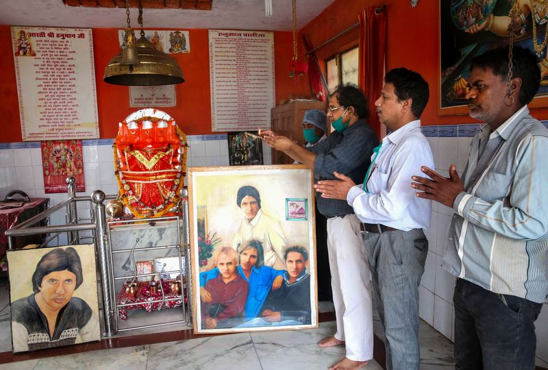 Bhopal: Fans of Bollywood mega star Amitabh Bachchan pray for his speedy recovery from COVID-19, at a temple in Bhopal, Sunday, July 12, 2020.