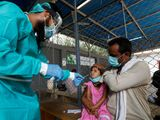 Nasal swab child Pakistan coronavirus protective gear