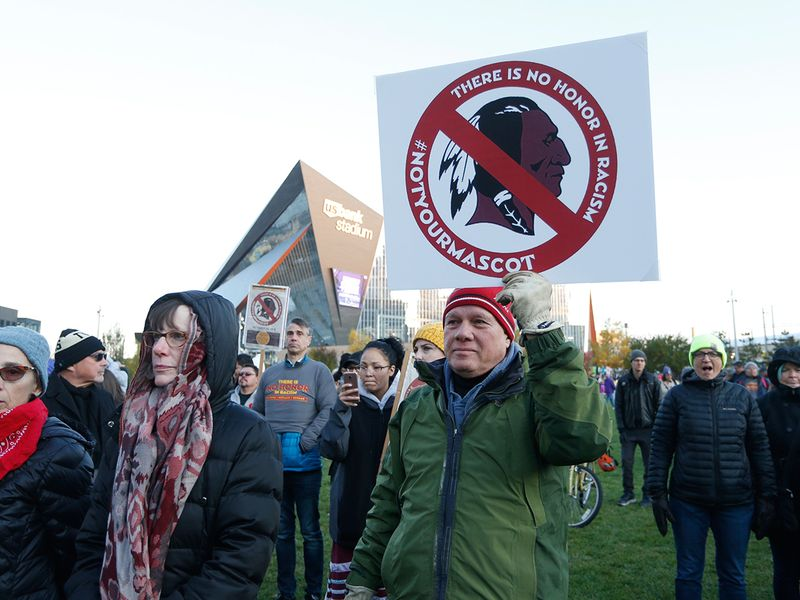 Protesters call for Washington to ditch the Redskins name and logo