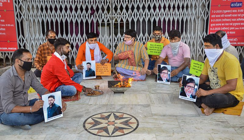 Ranchi: Fans of Bollywood mega star Amitabh Bachchan and his son Abhishek Bachchan perform 'hawan' for their speedy recovery from COVID-19, outside a temple in Ranchi, Sunday, July 12, 2020. (PTI Photo) (PTI12-07-2020_000056B)