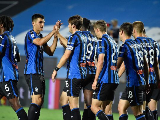 Atalanta players celebrate against Brescia