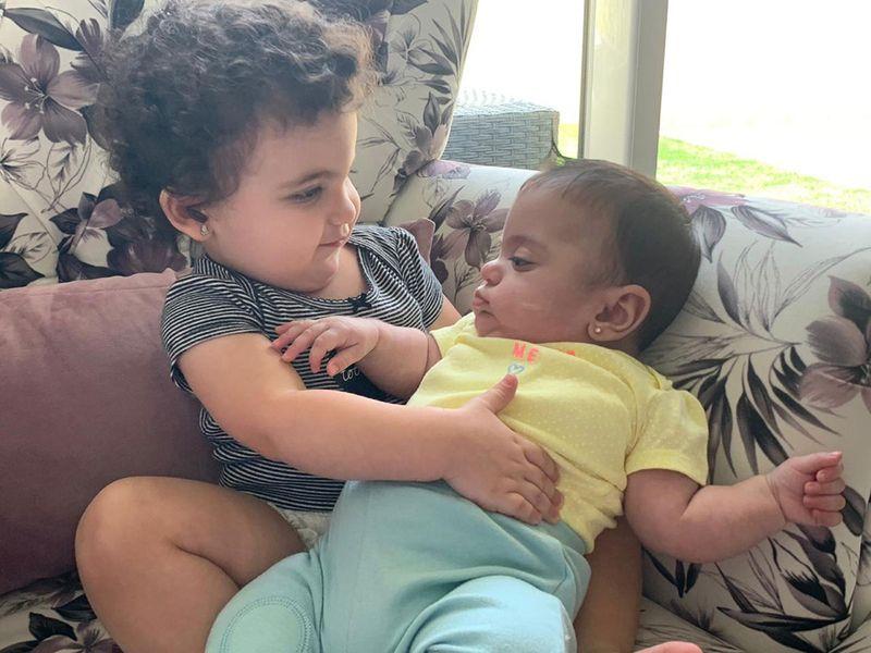 Kaitlyn lovingly holds baby Krista