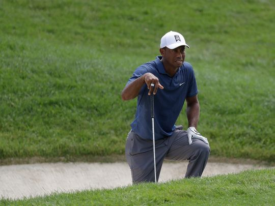 Tiger Woods looks toward the fourth hole during the second round of the Memorial golf tournament, Friday, July 17, 2020, in Dublin, Ohio. (AP Photo/Darron Cummings)
