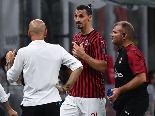 AC Milan's Zlatan Ibrahimovic argues with coach Stefano Pioli after his substitution