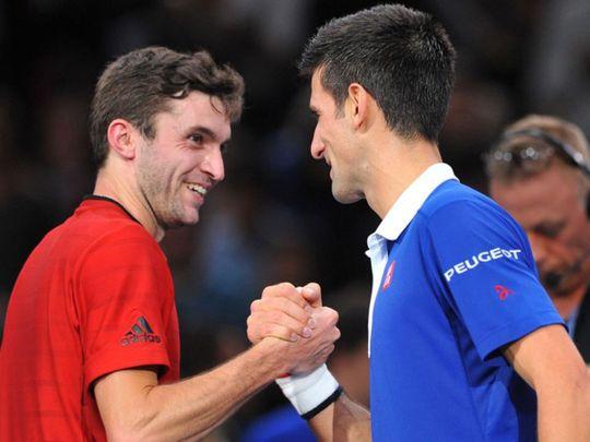 Gilles Simon with Novak Djokovic