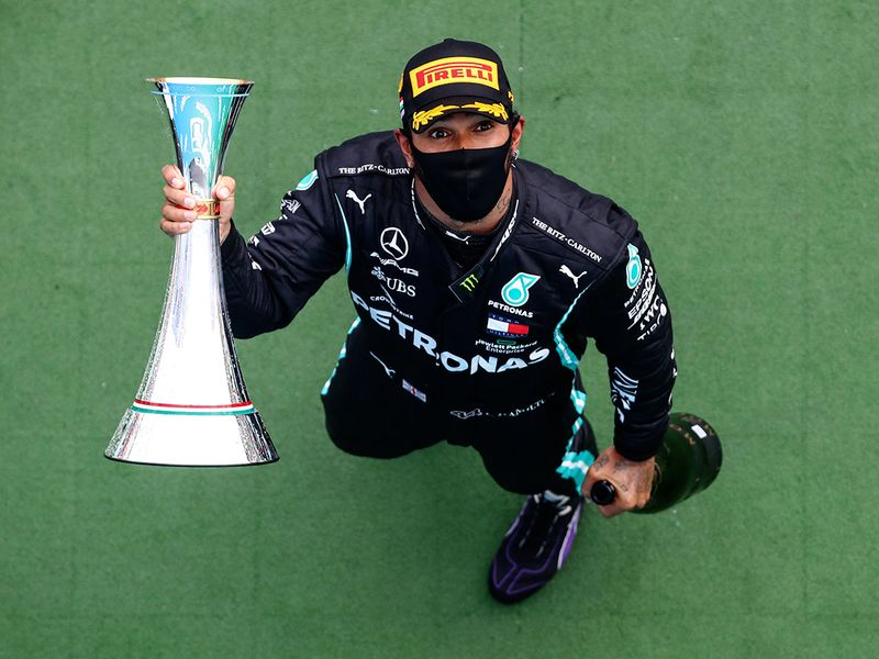 Lewis Hamilton with the trophy in Hungary