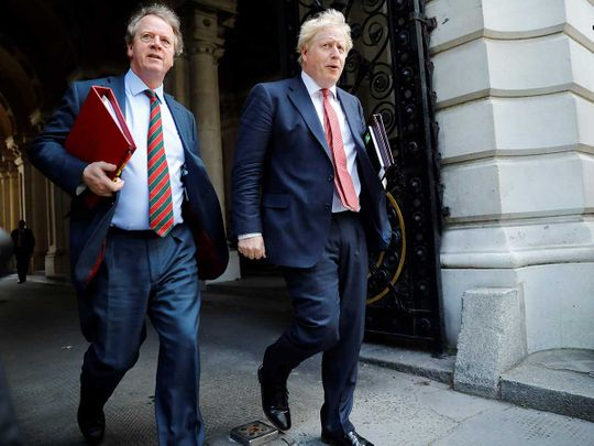 Britain's Prime Minister Boris Johnson (R) and Britain's Scotland Secretary Alister Jack London