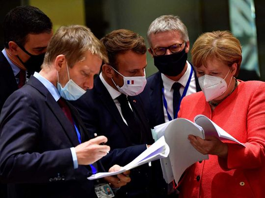 Spain's Prime Minister Pedro Sanchez (L), French President Emmanuel Macron (C) and German Chancellor Angela Merkel