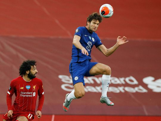 Chelsea's Marcos Alonso in action with Liverpool's Mohamed Salah
