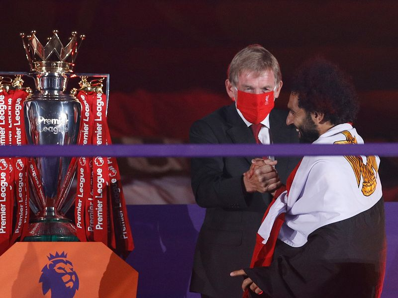 Kenny Dalglish congratulates Liverpool's Mo Salah