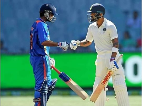 Virat Kohli bumps fists with his younger self on an Instagram post