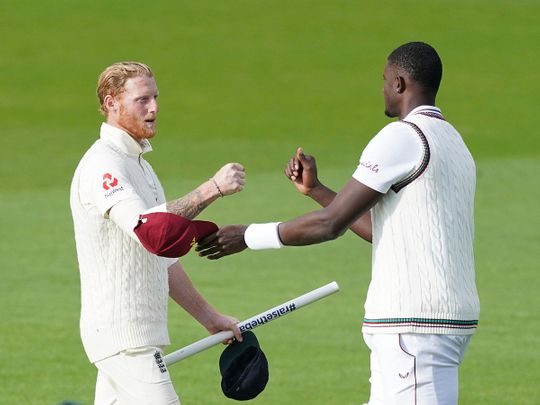 West Indies' captain Jason Holder, right, congrqatulates England's Ben Stokes after their win on the last day of the second Test
