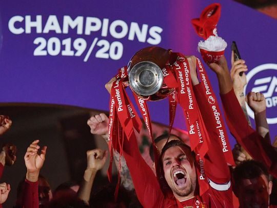 Liverpool's Jordan Henderson and teammates celebrate with the Premier League trophy