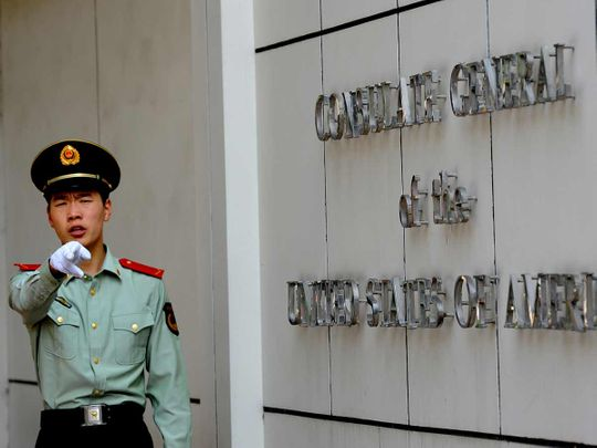 This file photo taken on September 18, 2012 shows a Chinese paramilitary policeman gesturing to photographers at the entrance to the US consulate in Chengdu, southwest China's Sichuan province.