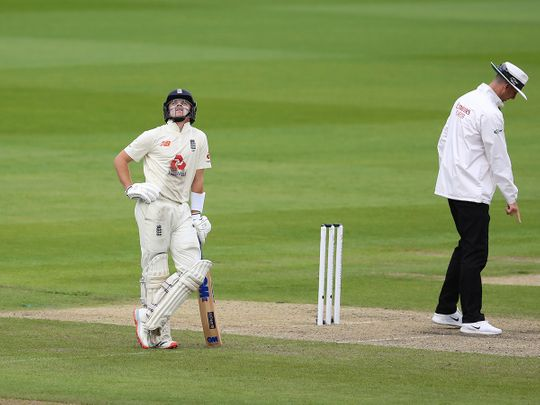 England's Ollie Pope, left, looks skywards during the first day of the third Test matchagainst West Indies at Old Trafford