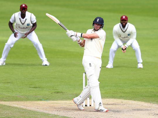 England's Stuart Broad plays a shot during the second day of the third cricket Test match against West Indies at Old Trafford.