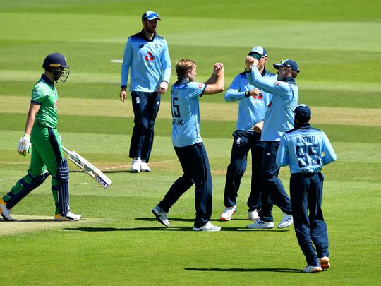 England's David Willey, centre, celebrates against Ireland