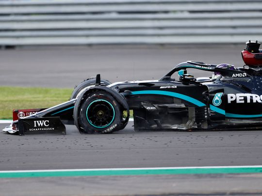 Lewis Hamilton's tyre deflated on the final lap of the British Grand Prix.