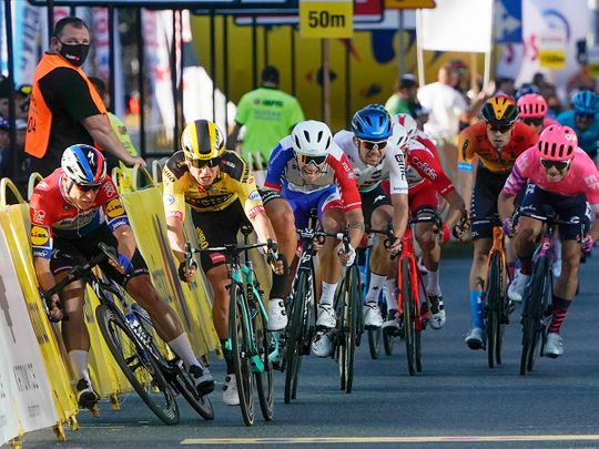 Dutch cyclist Fabio Jakobsen, left, hits side barriers after colliding with Dylan Groenewegen, 2nd left, on the final stretch of the opening stage of the Tour de Pologne