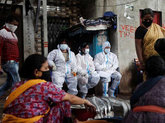 Health workers India covid coronavirus Mumbai slum