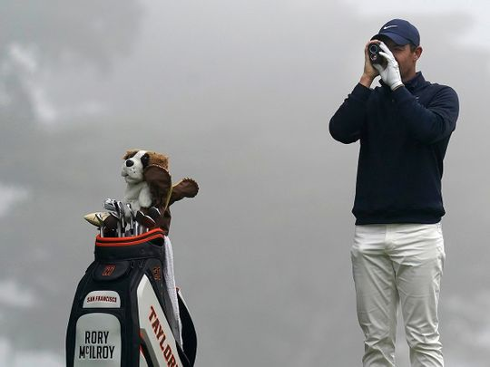 Rory McIlroy surveys the course at Harding Park
