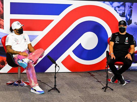 Mercedes' drivers Lewis Hamilton and Valtteri Bottas discuss the 70th Anniversary Grand Prix at Silverstone