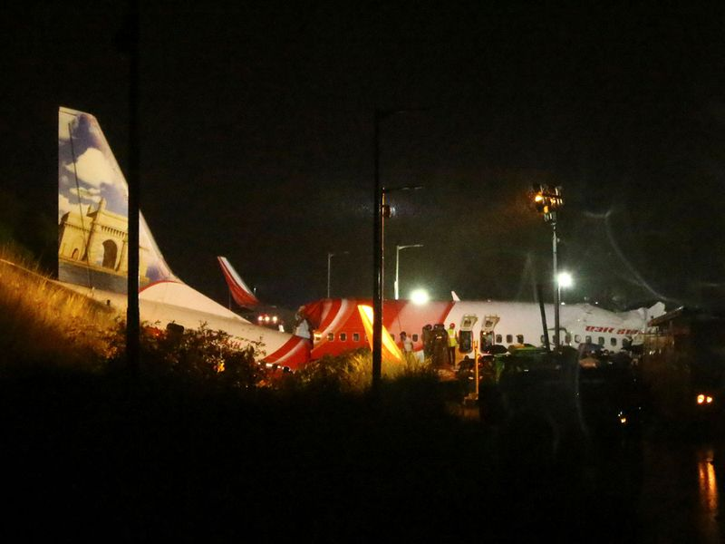 Rescue workers look for survivors after a passenger plane crashed when it overshot the runway at the Calicut International Airport in Karipur, in the southern state of Kerala