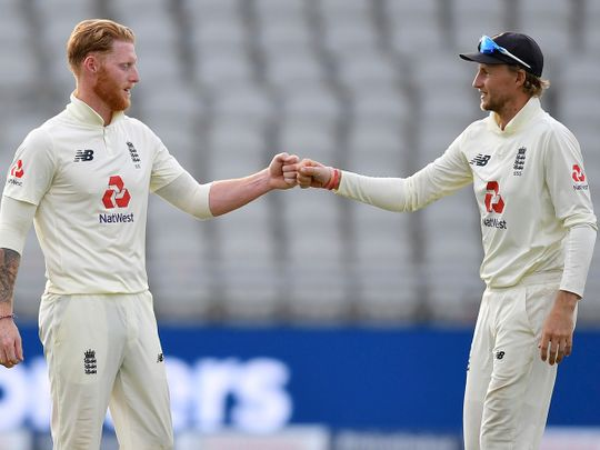 England captain Joe Root, right, fist bumps with teammate Ben Stokes at the end of the third day of the Test match against Pakistan at Old Trafford