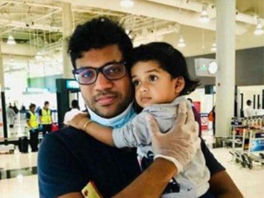 Indian expat Murtaza Faisal holding his daughter Aysha Dua