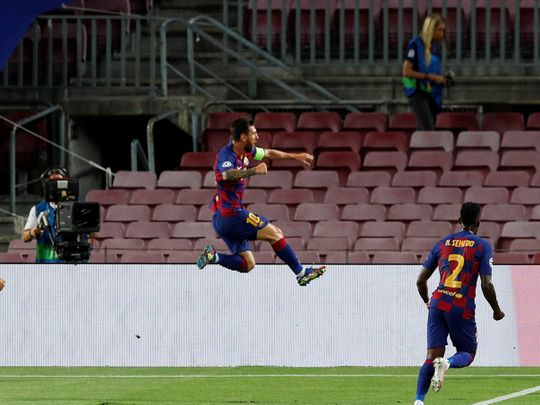 Lionel Messi celebrates his strike for Barcelona against Napoli.