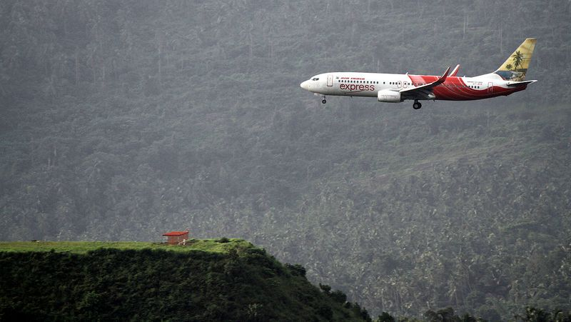 An Air India Express plane landing at Kozhikode Calicut International Airport (CCJ),