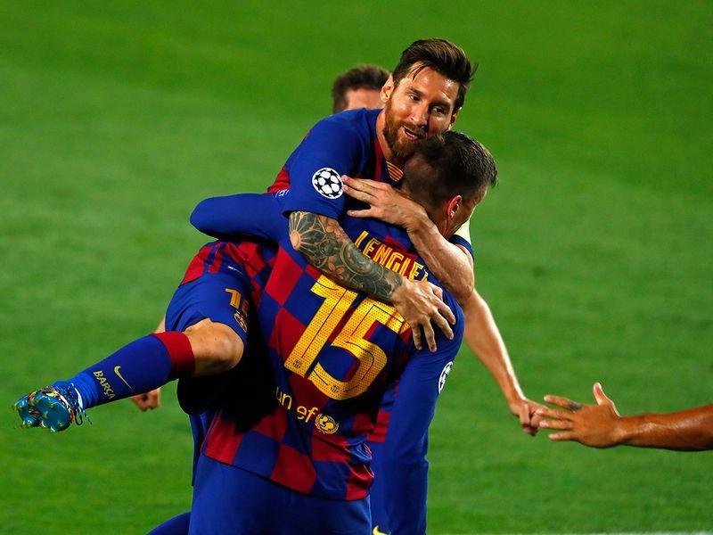 Lionel Messi celebrates his strike against Napoli.