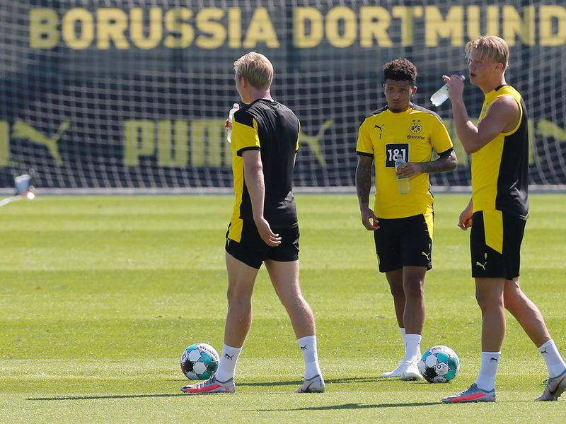 Jadon Sancho, centre, is back training with Borussia Dortmund