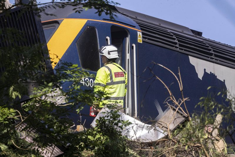 Photos: Three dead, 6 injured after train derails amid storms in ...