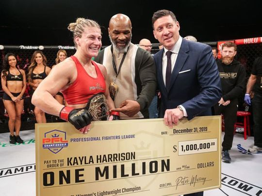 PFL champion Kayla Harrison, with boxing legend Mike Tyson and PFL CEO Peter Murray