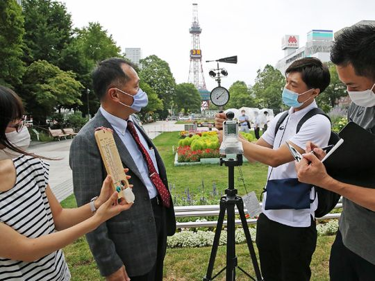 Yasuo Mori (2nd L), Deputy Executive Director of Tokyo 2020's Games Operations Bureau, and officials check the temperature and wind speed in the field verification of the Games Organizing Committee for holding the Tokyo Olympics Marathon and Racewalking in Sapporo on August 6.