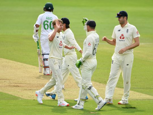 England's Sam Curran, second left,and James Anderson, right, celebrate with teammates after the dismissal of Pakistan's Abid Ali in Southampton