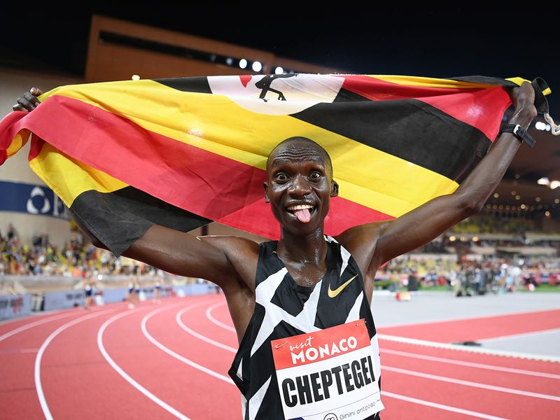 Uganda's Joshua Cheptegei celebrates after breaking the wold record in the men's 5,000m final during the Diamond League athletics meeting in Monaco