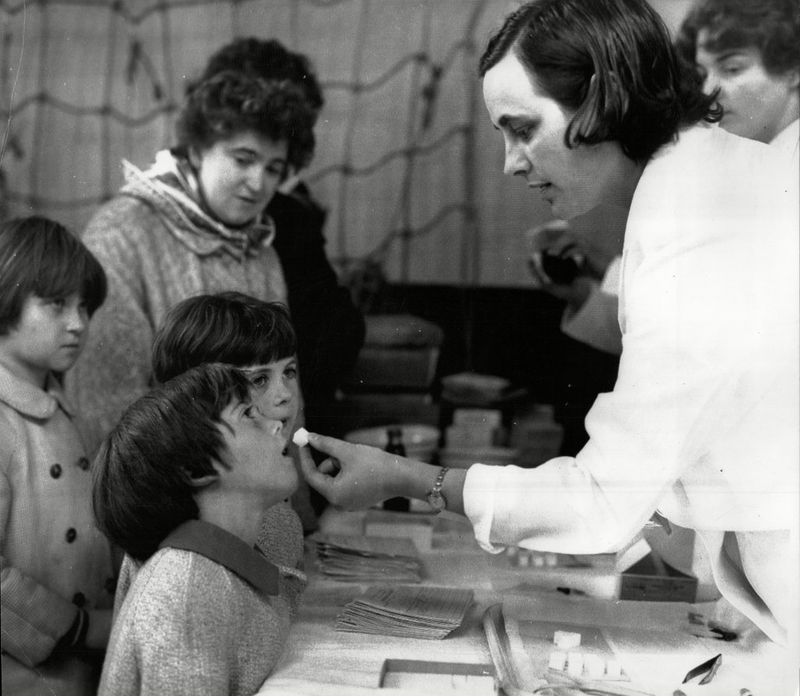 Children in Blackburn, Britain, receiving doses of the oral polio vaccine (packed as a sugary treat) in 1965.