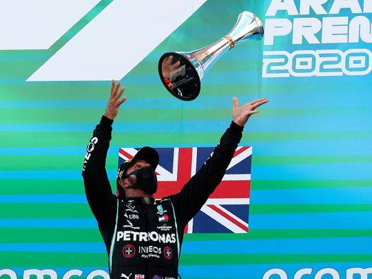 Lewis Hamilton celebrates victory on the Spanish GP podium, his 156th