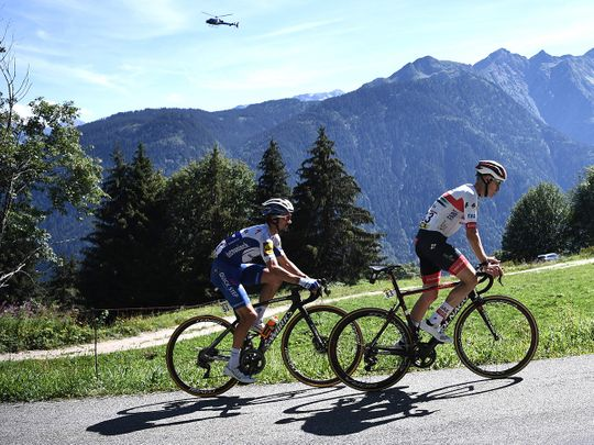 Team Deceuninck riderJulian Alaphilippe and Team UAE Emirates' David De la Cruz climb during the fourth stage of the 72nd edition of the Criterium du Dauphine