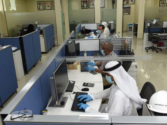 Stock Dubai customs staff at work