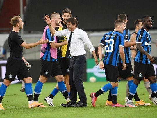 Inter Milan coach Antonio Conte congratulates his players after the Europa League win over Shakhtar Donetsk