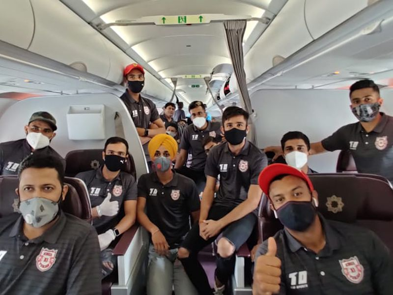Kings XI Punjab players wear their masks on the flight to the UAE