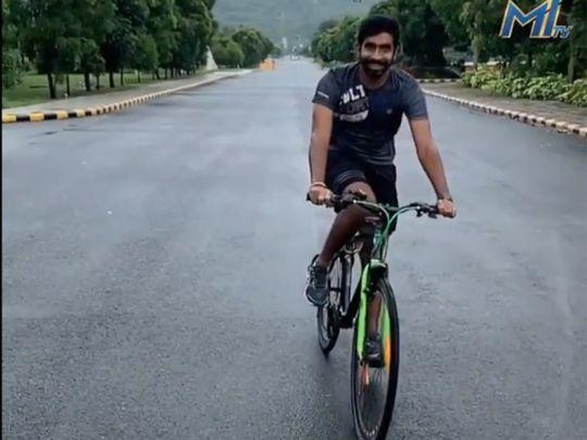 Mumbai Indians' Jasprit Bumrah on his bike