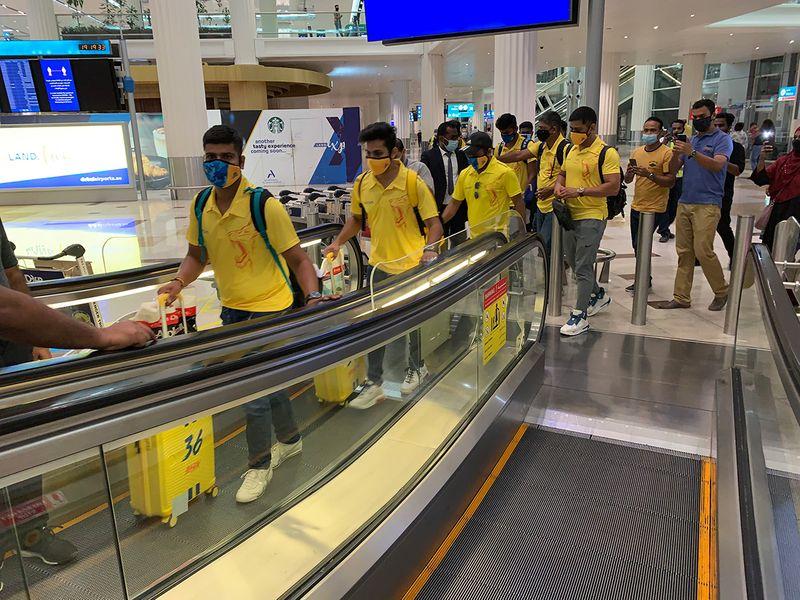Chennai players make their way through Dubai International Airport