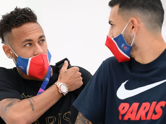 Paris St-Germain's Neymar and Leandro Paredes leave the team hotel in Lisbon on the way to training