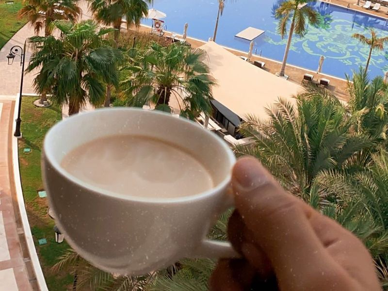 Kolkata Knight Riders' Nitish Rana shows the view from his hotel room over a cup or coffee