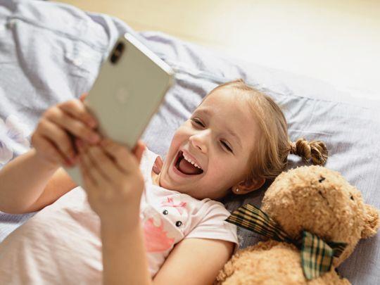 Toddler using smartphone