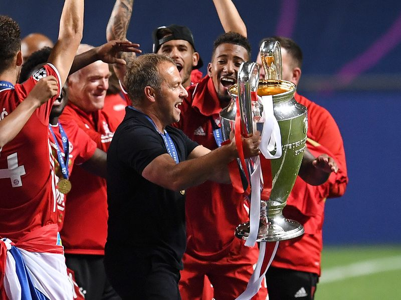 Hansi Flick lifts the Champions League trophy